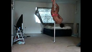 Stunning bitch showing her treasure with pole dance